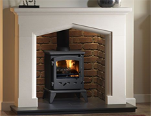 Swinford Stone Fireplace in limestone with Sirius stove by Capital Fireplaces